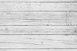 Wooden background. Old black and white painted fence in good condition. Solid wooden wall from weathered cracked boards. Barn wood wall.