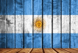 Wooden background with a flag of Argentina.