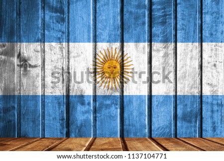 Wooden background with a flag of Argentina. #1137104771