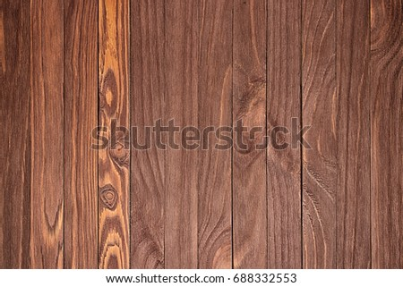 Wooden background with copyspace, brown striped timber desk, old table or floor #688332553