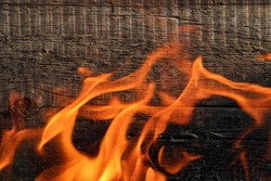 wooden background with fire