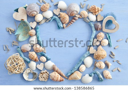 Wooden background with sea shells and hearts - stock photo