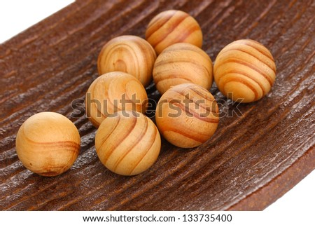 Wooden balls in decorative plate close-up