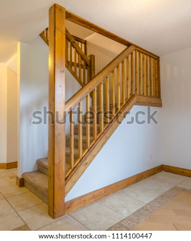 Wooden banister and column in home
