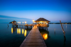 Wooden bar in sea and hut with night sky in Koh Mak at Trat, Thailand. Asia Summer, Travel, Vacation and Holiday concept.
