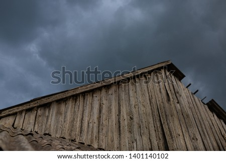 Wooden barn isolated against dramatic blue sky #1401140102