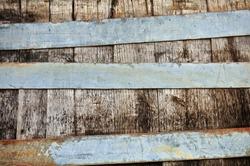 Wooden barrel and rusty metal stripes texture.