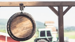 wooden barrel hanging on metal  for a sign on