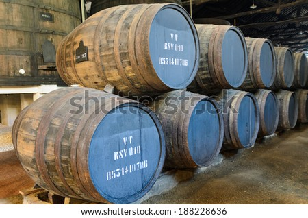 Wooden barrels used for port wine aging in Porto, Portugal