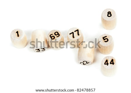 wooden barrels with lotto numbers on a white background