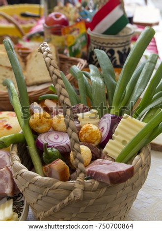 Wooden basket filled with traditional meat products and vegetables Stock photo ©