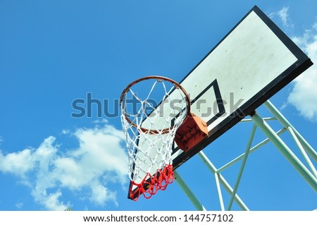 Wooden basket hoop on blue sky.