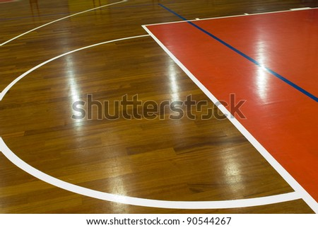 Wooden basketball court. Indoor sports playground