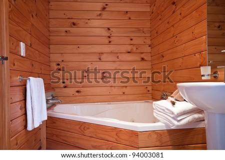 Wooden bathroom interior in mountain lodge apartment. Fox Glacier Lodge, Fox Glacier, West Coast, South Island, New Zealand.
