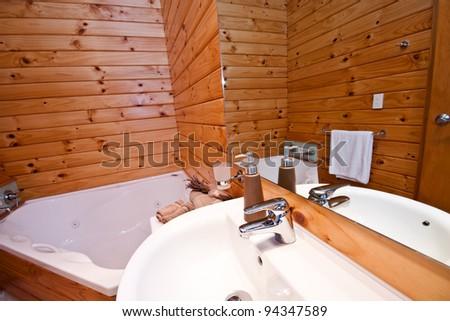 Wooden bathroom interior in mountain lodge. Fox Glacier Lodge, Fox Glacier, West Coast, South Island, New Zealand.