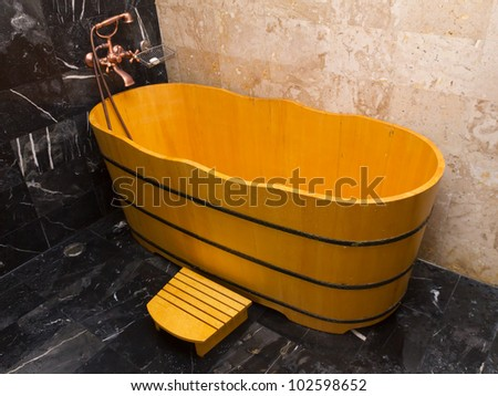 Wooden bathtub in a bathroom