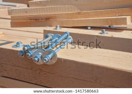 Wooden beams for steel structure for further construction. Fastening elements of wooden beams among themselves. Bolted connection wooden beams. #1417580663
