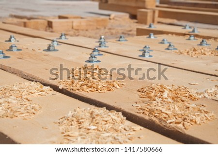 Wooden beams for steel structure for further construction. Fastening elements of wooden beams among themselves. Bolted connection wooden beams. #1417580666