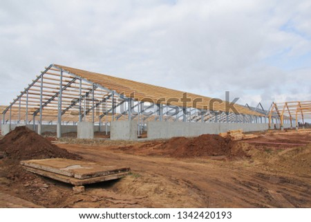 Wooden beams on a metal frame. Construction of agricultural buildings. The construction of the barn. Agriculture. #1342420193