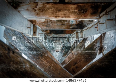 Wooden beams under a pier. Focus. Close-up. Narrowed down. #1486379456