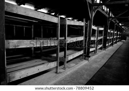 wooden beds inside Auschwitz barrack
