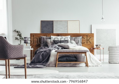 wooden bench and armchair in...