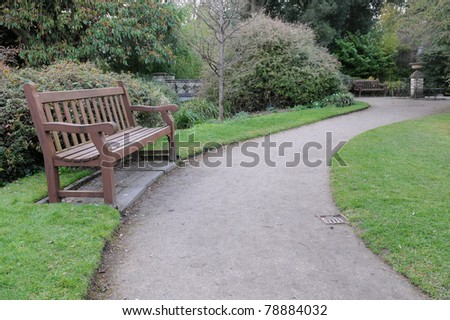Wooden Bench and Winding Path in a Tranquil Garden