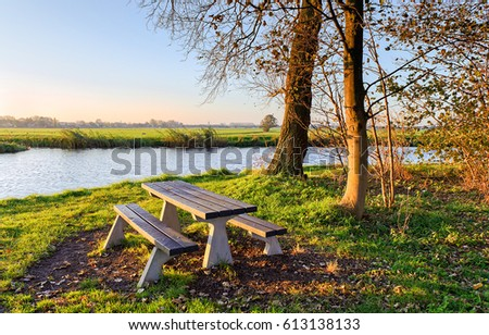 wooden bench at river shore...