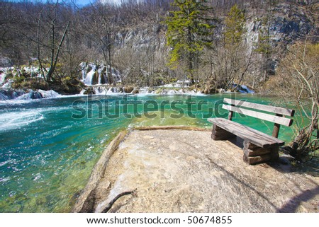 Wooden bench at the Plitvice National Park lakes and waterfalls