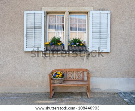 Wooden Bench For Rest Under The Window Stock Photo 108440903 ...