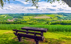 Wooden bench in nature scene. Mountain valley bench view