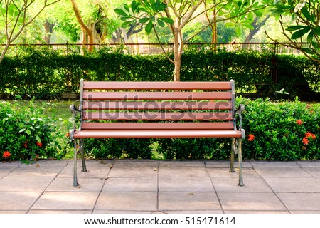 Wooden bench in the city park - Shutterstock ID 515471614