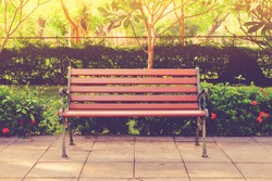 Wooden bench in the city park vintage color