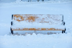 wooden bench in the snow. Park, winter in Russia