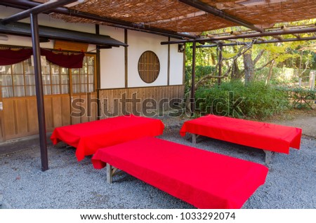 wooden bench with red cover in...