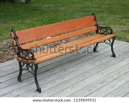 wooden bench with steel legs #1239849931