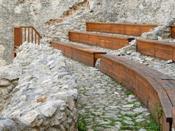 Wooden benches used for theater in the ruins of medieval castle, Topoľčany casle, Podhradie, Slovakia