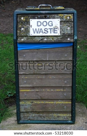 wooden bin for dog waste at the park