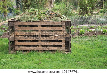 wooden bin  for organic waste in a garden