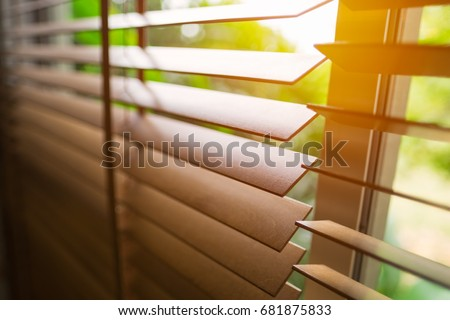 Wooden blinds with sun light.