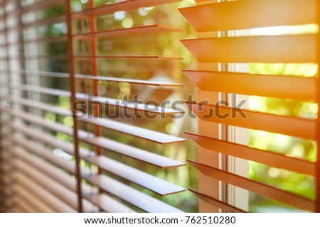 Wooden blinds with sun light. #762510280