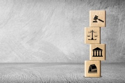 Wooden block cube shape with icon law legal justice on a desk