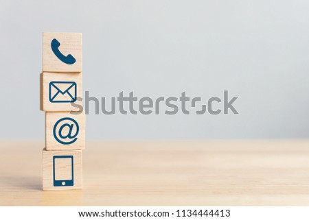 Wooden block cube symbol telephone, email, address and mobile phone. Website page contact us or e-mail marketing concept #1134444413