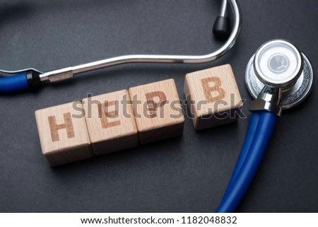 Wooden block form the word HEP B with stethoscope. Medical concept. Stock photo ©