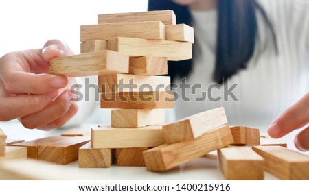 wooden block Planning, risk and strategy of project management in business, with hand pull wood block #1400215916