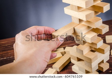 wooden block tower stack game on wooden board background #604765109