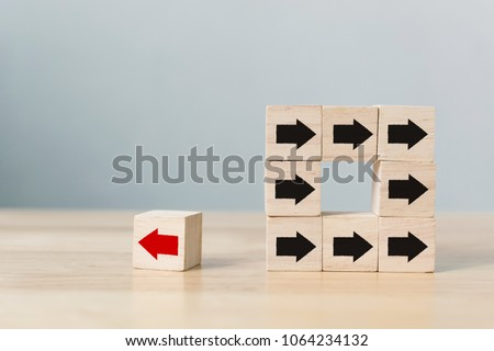 wooden block with red arrow...