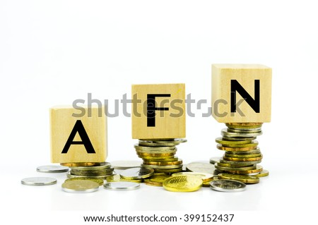 Wooden block with stacked coins with word AFN (Afghan Afghani) country currency code