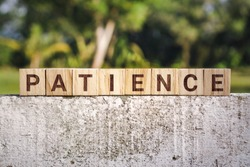 Wooden Block With The Word Patience