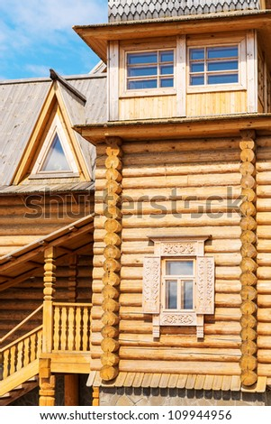 Wooden blockhouse with decorated windows, Russian traditional architecture.